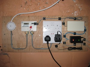 The server room meter with sensor, MK120 (white box), and junction box (black with LEDs).